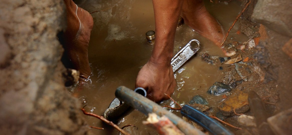 A photo of a plumber repairing a leak - Maintenance Plumber Perth: Element Plumbing & Gas